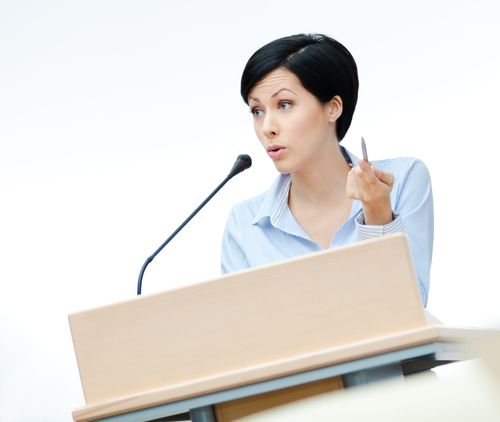 Vortragende am Rednerpult